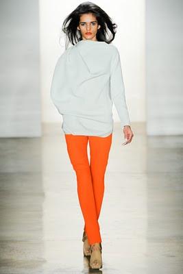 Model wearing orange skinny jeans from Costello Tagliapietra's Fall 2011 runway show