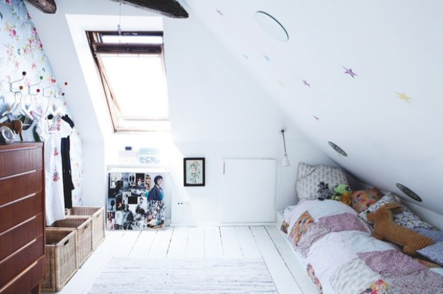 Bright white girls loft bedroom with dark wood dresser