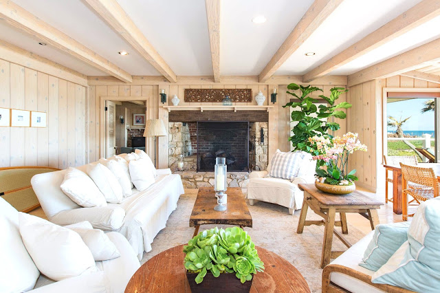 malibu estate wood paneled living room fireplace real estate listing