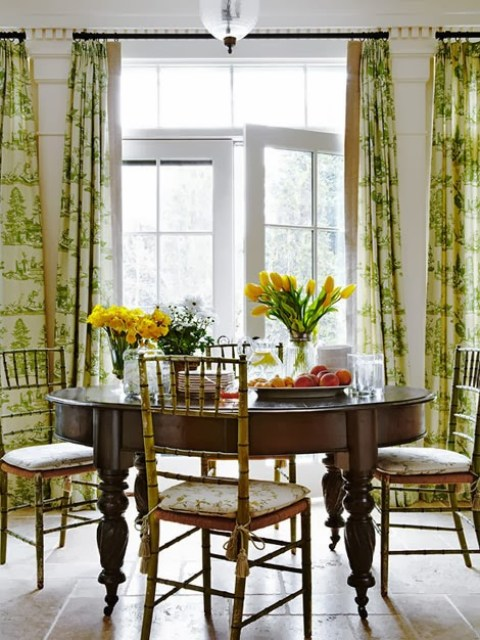 Dining room with vintage faux bamboo chairs, green toile curtains in a traditional dining room