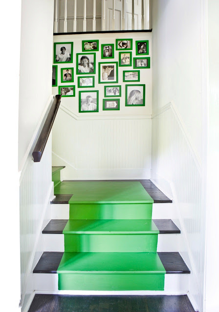 Staircase with kelly green stairs matching bright green framed pictures arrangement