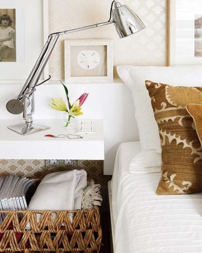Close up of the white floating nightstand with a wicker basket underneath for more storage