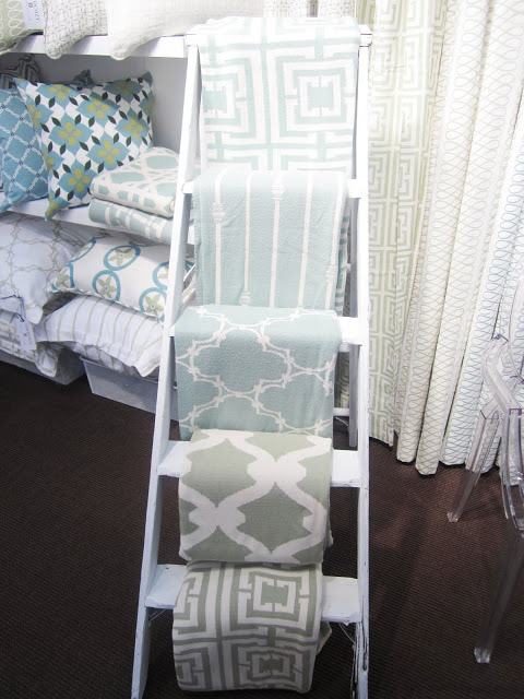 COCOCOZY throws displayed on a ladder at the New York International Gift Fair