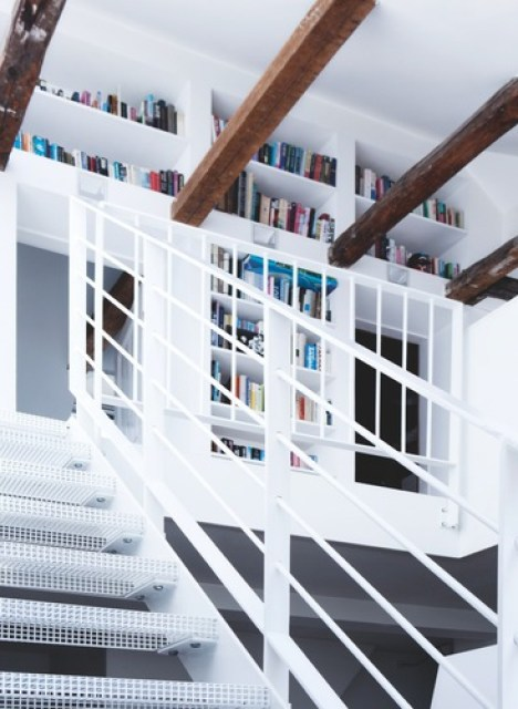 White stairs to the second floor with built in book cases