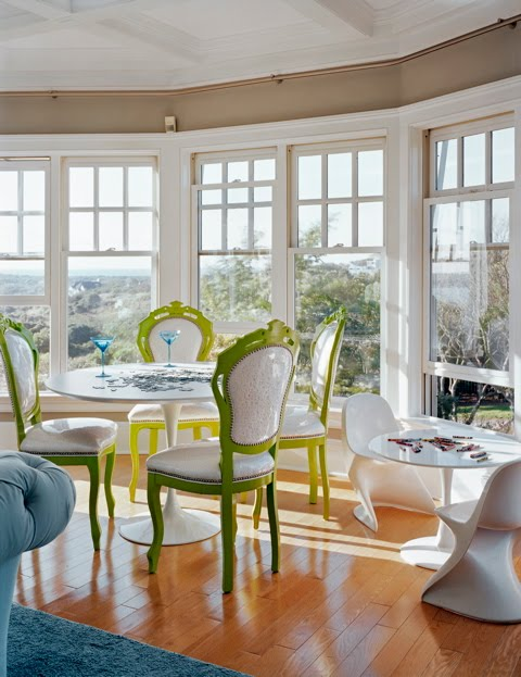 Breakfast nook by Ghislaine Vinas with two Saarinen tables. One with classic upholstered dining chairs and the other with mini Panton chairs