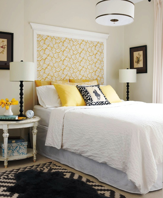 "Master bedroom with black, white and yellow wall mounted ""headboard"" made of floral wallpaper and left over crown molding"