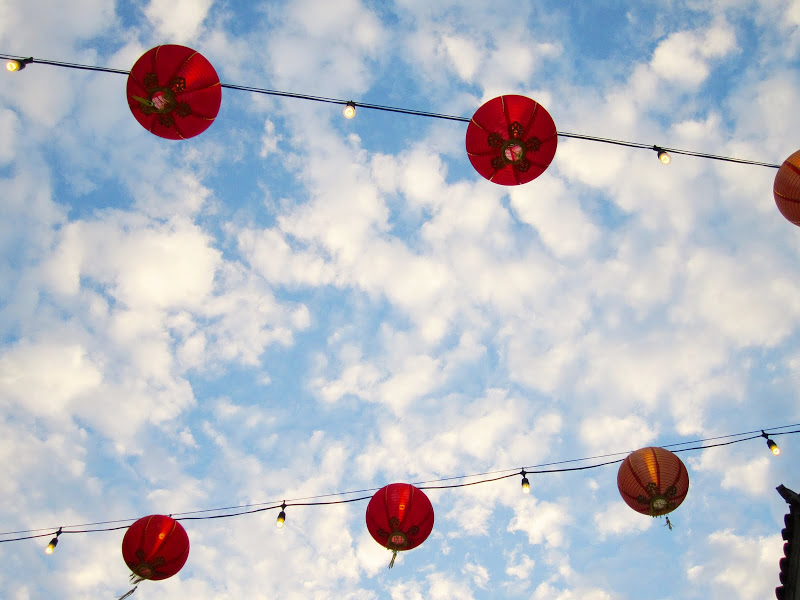 Blue sky with clouds and red hanging lanterns