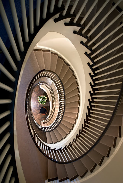 View from the top of a spiral staircase by Peter Pennoyer