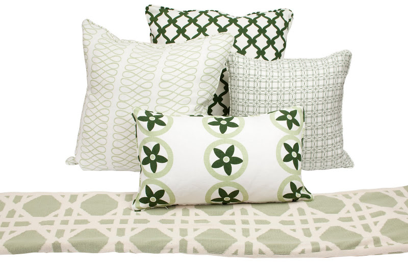 Mix of COCOCOZY pillows and throws all in green