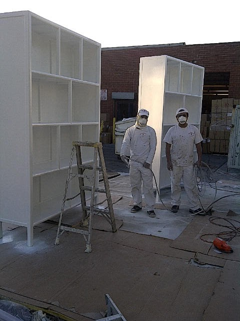 9 foot display cases in the process of being painted white