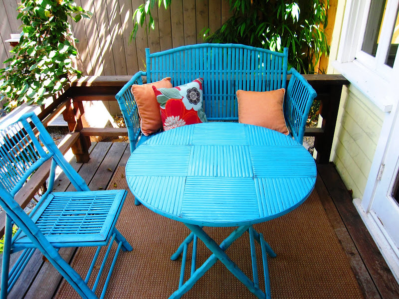 Turquoise blue rattan dining set on a deck in Venice Beach, CA