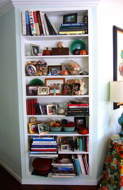 White built in bookshelf in a living room