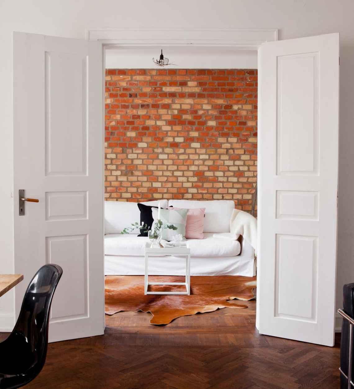 Exposed brick wall in Malmo - via Coco Lapine Design