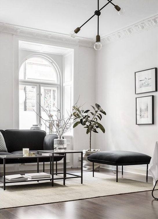 White walls and walnut floors - via Coco Lapine Design