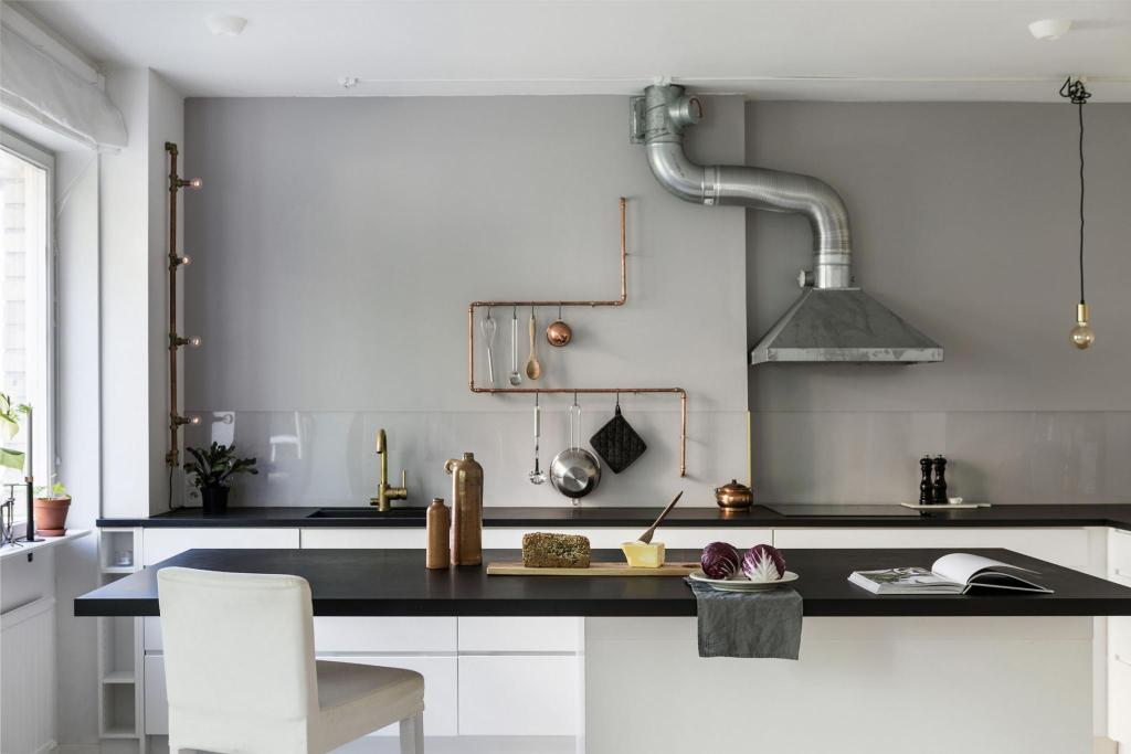 Kitchen with a copper rail - via Coco Lapine Design blog