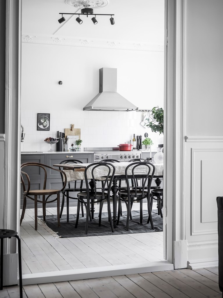Grey kitchen with large dining area - via Coco Lapine Design blog