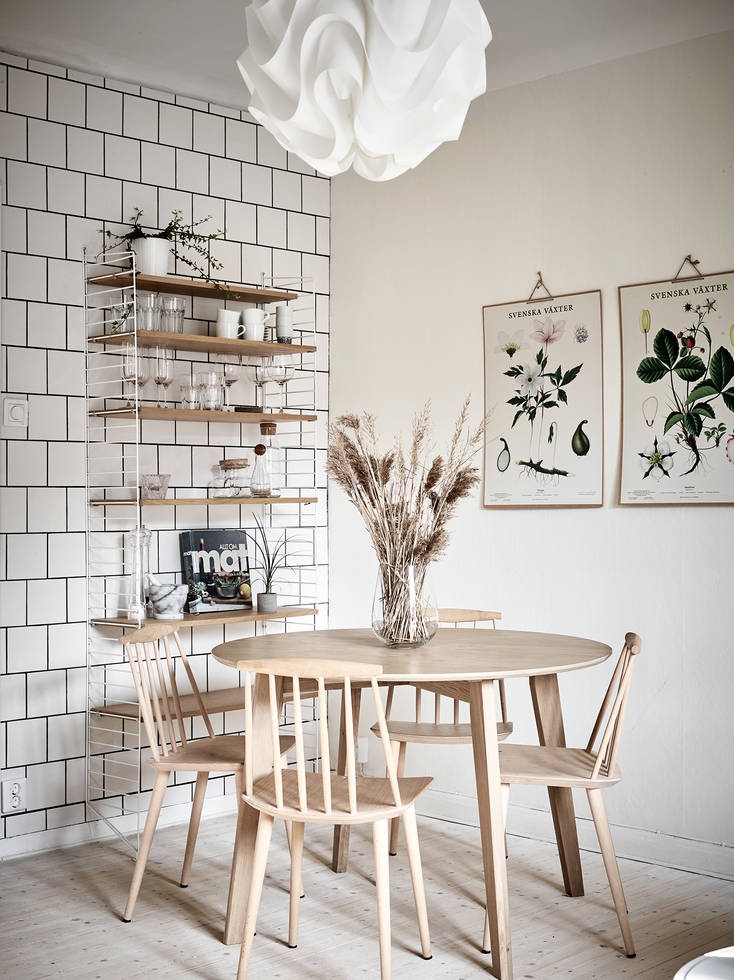 Cozy kitchen with an exposed brick wall