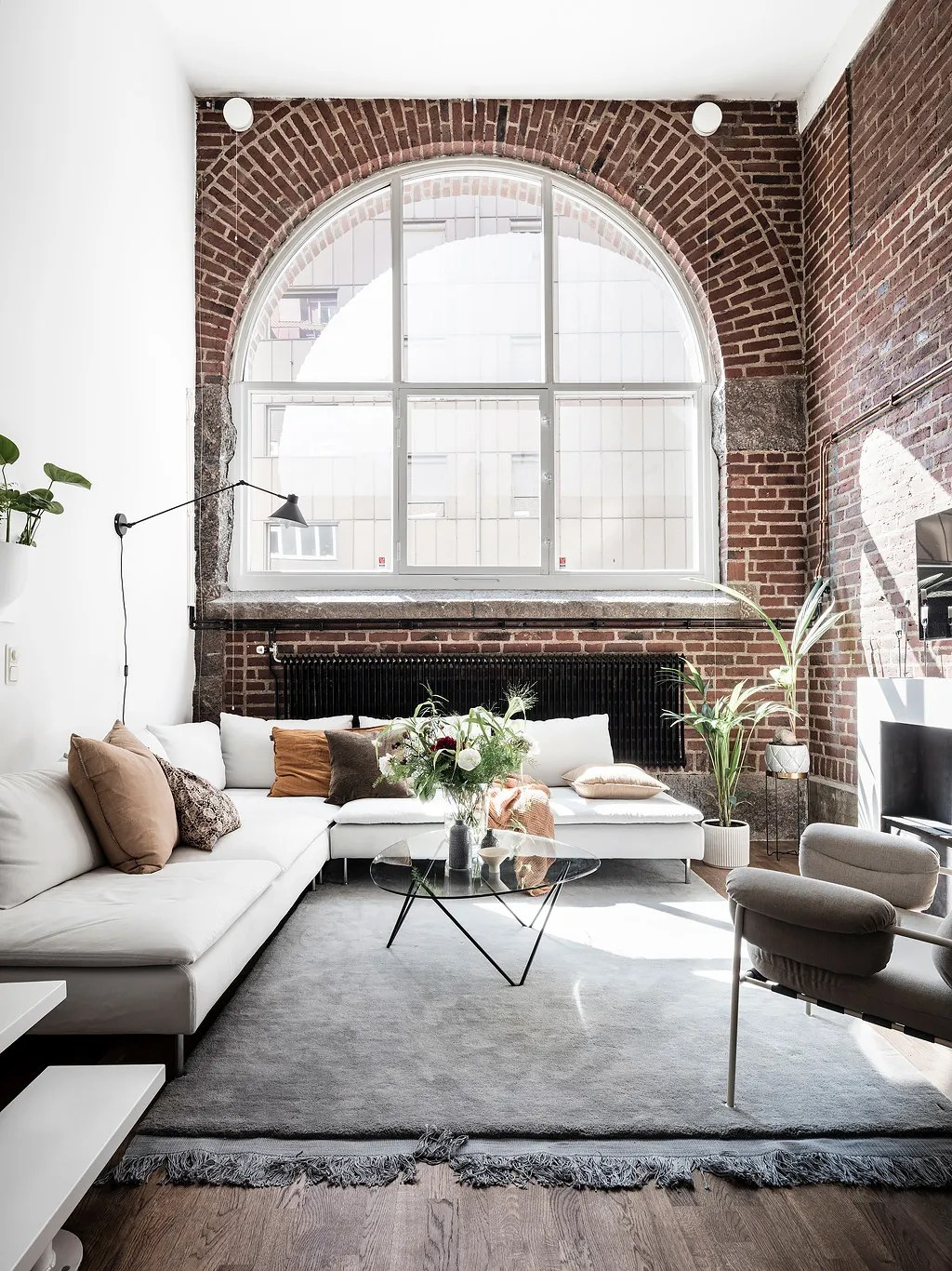 Loft with an exposed brick wall