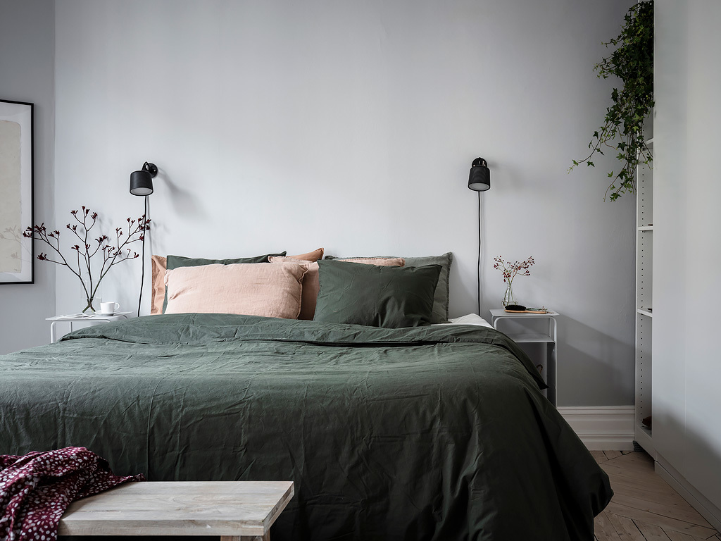 Cozy bedroom in green and grey