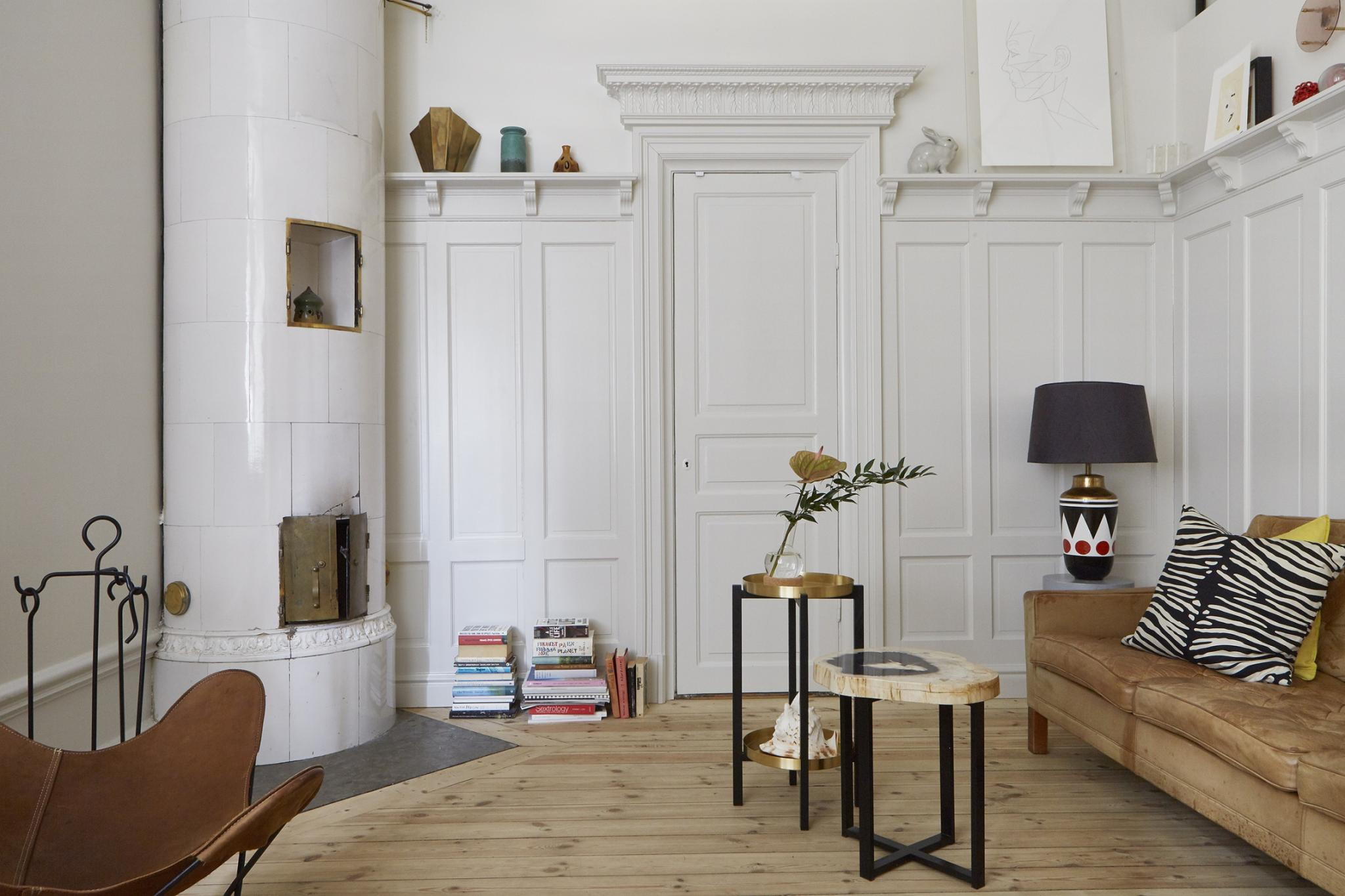 The First Thing You See When Looking At This Quirky Stockholm Apartment Is  The Brass Panelled Kitchen In The Middle Of The Space, Which Is A Real Eye  ...