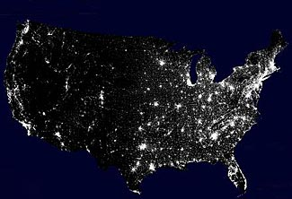 This map expresses US population clusters by showing one white dot per 7500 people.
