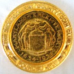 Obverse of Montgomery County Coin Club medal with standard logo that was gold plated for the 50th Anniversary.