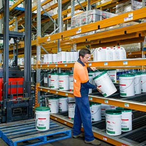 A Man Stock Goods Into Warehouse Shelves