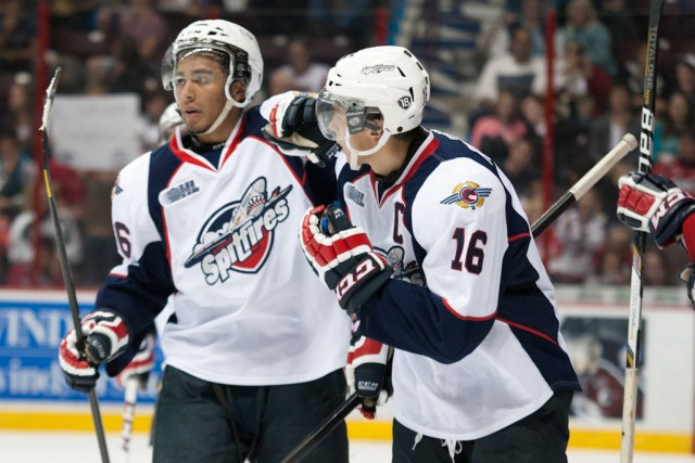 Josh Ho-Sang (left) celebrates a goal.  (Photo: Tim Cornett, WindsorSpitfires.com)