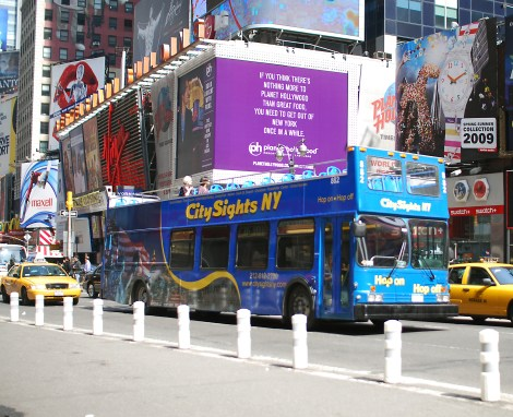 The CitySights bus travels through Times Square.  Photo by Hal Wiener, from A View From the Bus, A Tour Guide Takes Manhattan,  by Carla Stockton, Felicia Brings and Hal Wiener.