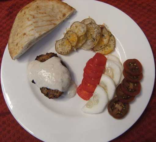 A plate of Kafta and tahini yogurt sauce. Get the recipe to make it at ComfortablyDomestic.com
