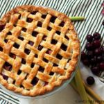 Sweet Cherry Rhubarb Pie marries plump sweet cherries with tart rhubarb for a juicy pie that's bursting with summer sunshine in every bite.
