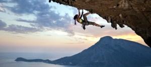 Young female rock climber at sunset, Kalymnos Island, Greece