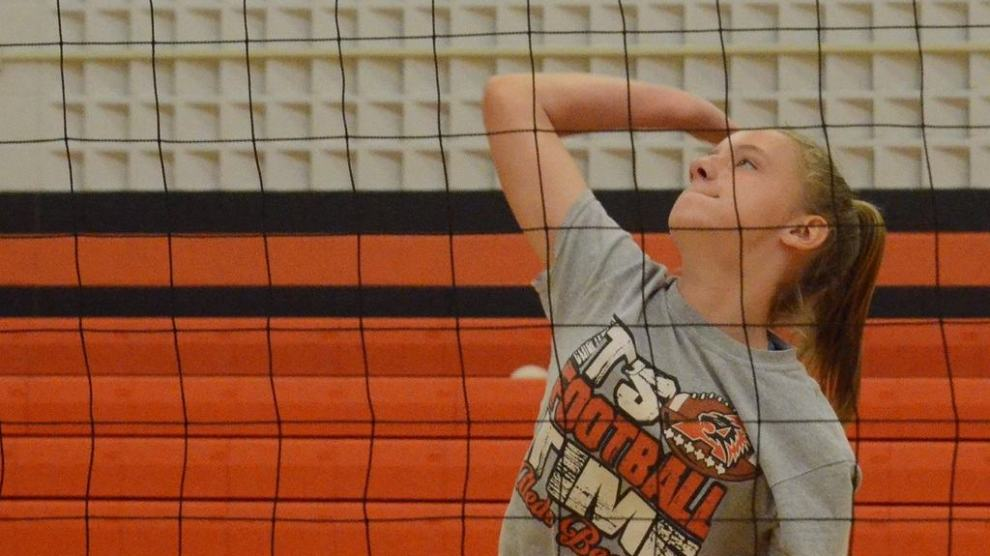 Sarah Summerhill slams down a spike Tuesday during the Ladycats Volleyball Camp at the Daniel Ninth Grade Campus gym. The camp concludes Thursday.
