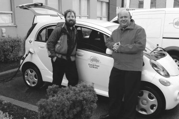 Grand River CarShare's Matthew Piggott and Kitchener councillor Berry Vrbanvoic check out the co-op's first electric vehicle - Photo courtesy Grand River CarShare