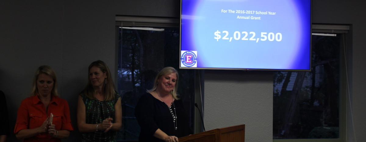Eanes Education Foundation Treasurer Annie Zucker (far right) announces the $2 million grant at the Eanes ISD Board of Trustees meeting April 26.
