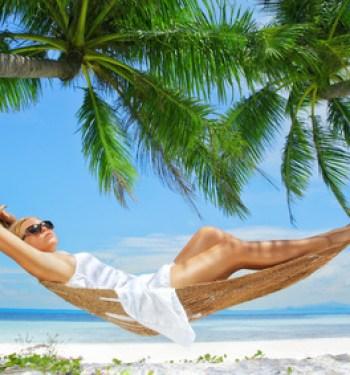 Lady On Tropical Beach Hammock
