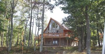 Prowl window log home front view