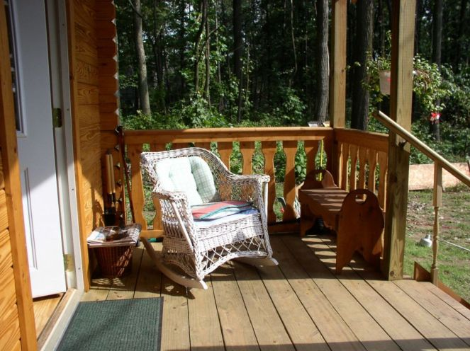small log cabin front porch