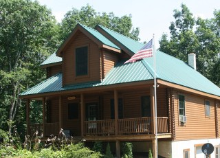 log home with metal roof
