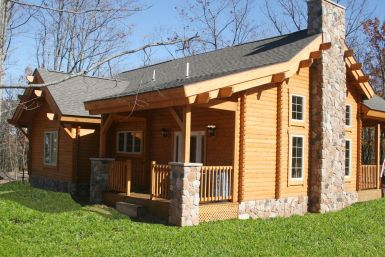 log home with stone