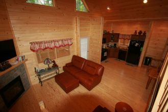 log home living space with fireplace