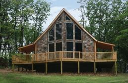 log house with stone veneer front