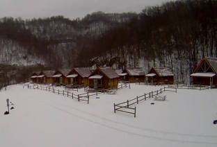 Conestoga log cabins in snow at Ashland Resort
