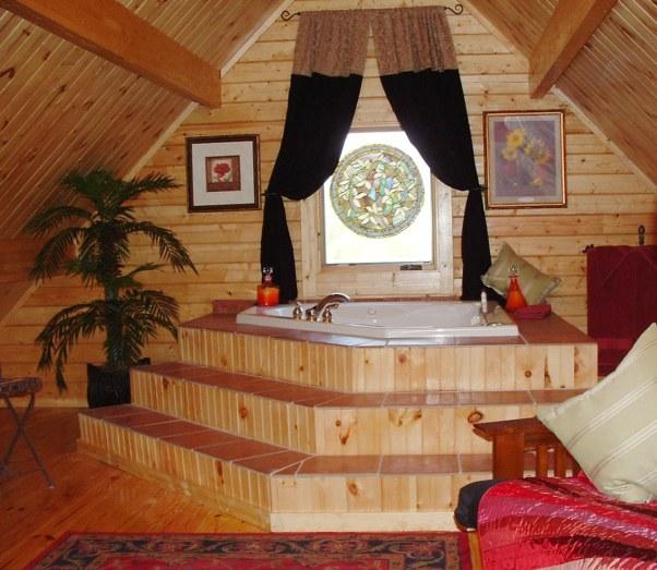 Spa tub in log cabin loft