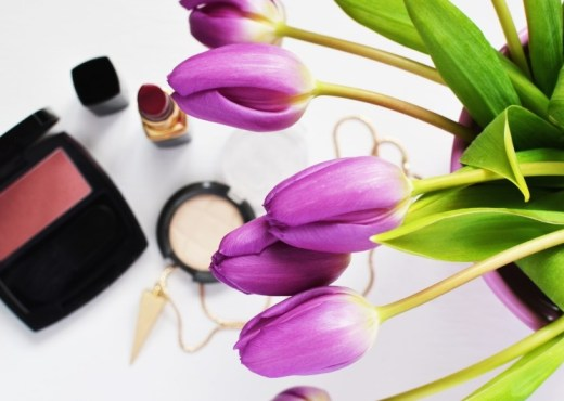 violet-tulips-and-cosmetics-on-table
