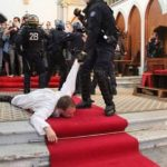 Transgender Police Officer Drags French Priest Out of His Church