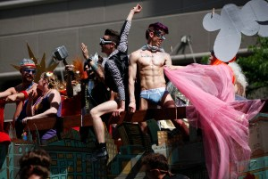 Revelers ride in a float during the gay pride parade in Salt Lake City, Utah, June 3, 2012. Over 300 active Mormons and more than 5,000 members of the Lesbian, Gay, Bisexual and Transgender (LGBT) community with their supporters marched in the parade as part of the Utah Pride Festival. REUTERS/Jim Urquhart (UNITED STATES - Tags: SOCIETY) ORG XMIT: SLC07
