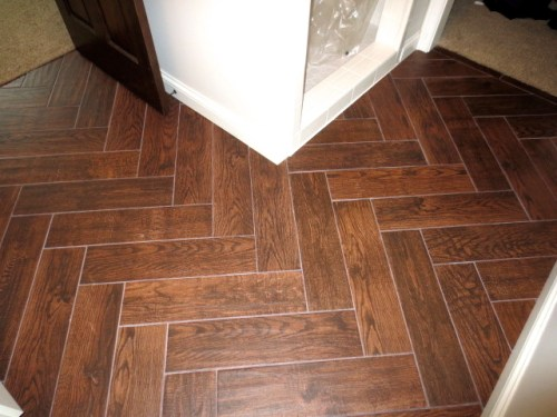 After picture of Jamie Molitor's herringbone Bathroom Wood Tile bathroom floor