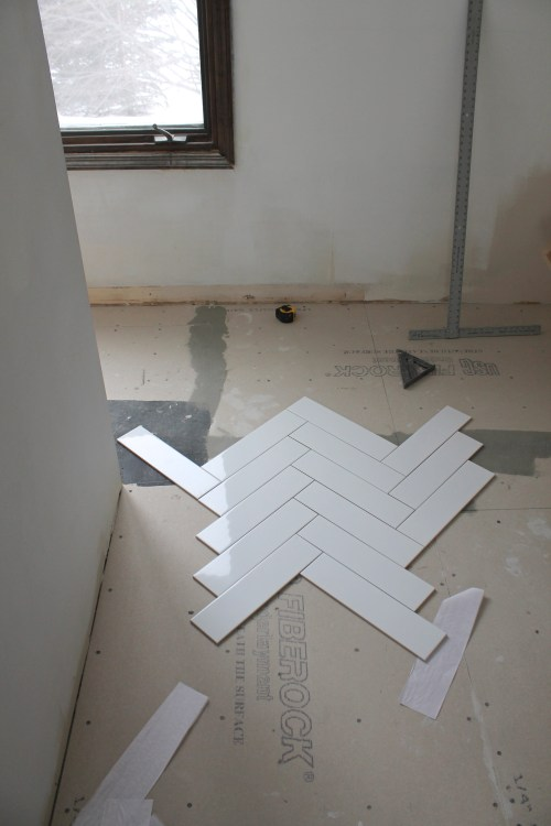 construction2style Placing Herringbone White Tile