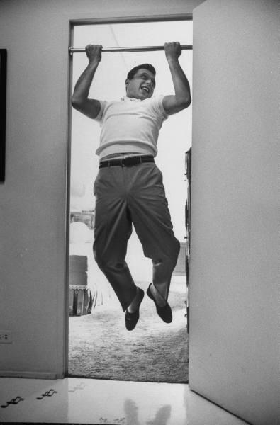 vintage man 1950s pull ups in doorway